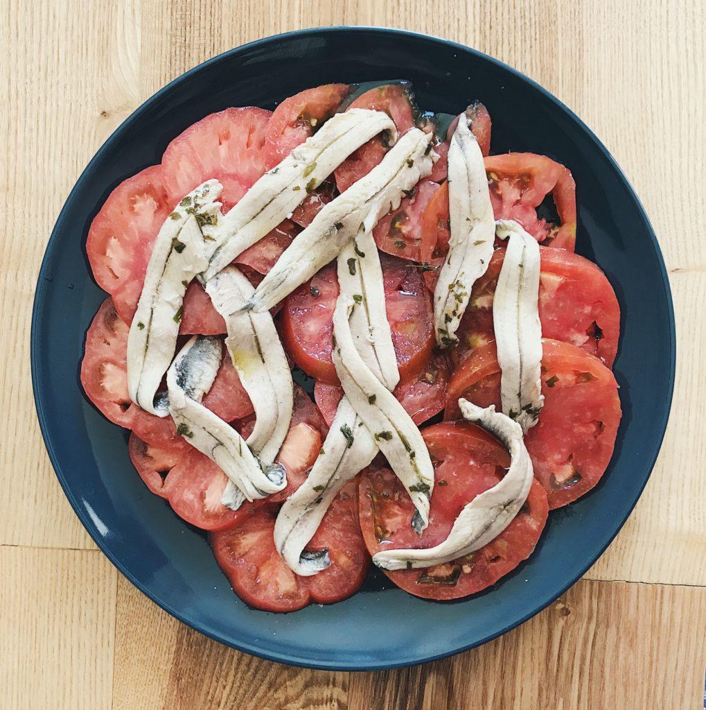 Por aí em Valência comendo tomates lindos com boquerones